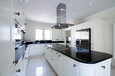 Woodall Homes - Kitchens - classic yet contemporary - cream shaker - granite work surfaces - island unit - Neff appliances