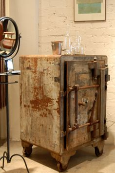 Looks like an old safe turned into a table, bar?