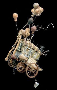 Rêve de roulotte...  Hissée par les ballons arrimés à son toit, elle quitte la terre pour s'élever vers les...