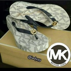 Mk sandals / flip flops / wedge sandles . Authentic  ..........Brand New with box Michael Michael Kors  Bedford Logo Platform Flip Flops Color navy Size 8 ***ALSO AVAILABLE IN size 6 No trades ...no PayPal. ..no low offers please *** Stick smush on bottom of right  shoe. MICHAEL Michael Kors Shoes Sandals