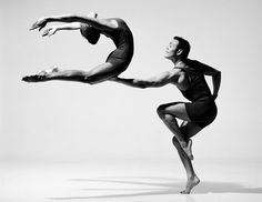 Graceful and dynamic photograph of dancers in motion by American photographer Lois Greenfield (born 1949) who has the ability to capture the human form in motion and her use of it as a compositional element in her art.
