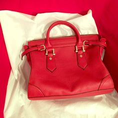 """New red handbag with adjustable shoulder straps. Attractive faux leather bag with gold hardware. Comes with adjustable shoulder strap. Perfectly sized at 14""""W x 11""""H. NWOT and priced to sell Bags Shoulder Bags"""