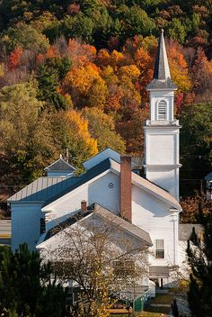 Classic white church in small valley in the forests of the southern Green Mountains near West brattleboro Vermont.