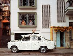 """""""Ambassador car decorated for a wedding.  Jodhpur Park, Kolkata, 1998."""" One of the ubiquitous features of Calcutta's architecture — visible here and there in Laura McPhee's ravishing new book — are the French windows and plantation-style shutters on older buildings."""
