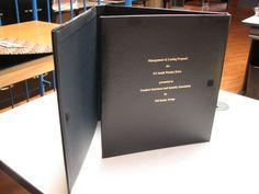 Trifold hard GBC binder