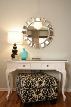 I love the idea of a cushion instead of a chair in front of the vanity. I want to be able to sit comfortably and cross my legs when I put my makeup on!