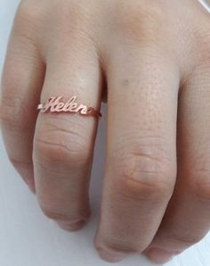 Check out this item in my Etsy shop https://www.etsy.com/listing/263594737/name-ring-personalized-name-ring-rose