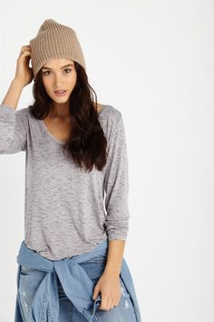 A long sleeve tee with a V neckline, mid length and loose fitted with cuffs at the sleeve. Model wears size S. Composition: 95% Viscose 5% Elastane