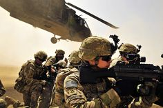 Pfc. Samuel Corsolini, 2nd Battalion, 25th Aviation Regiment, 25th Combat Aviation Brigade, pulls security with other Pathfinders as a UH-60 Black Hawk helicopter takes off after unloading his team and members of 2nd Afghan National Civil Order Patrol Special Weapons And Tactics Team in Kandahar province, Afghanistan, March 16. [US Army Flickr]