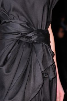 Black dress with twisted drape - modern elegance; fashion details // Ann Demeulemeester