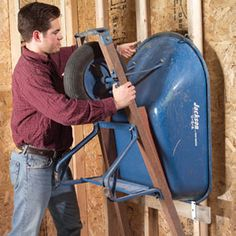 Don't waste floor space on your wheelbarrow—hang it on the wall.