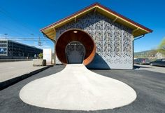 Gulskogen Bicycle Hotel Stashes Over a Hundred Bikes Behind an Intricate Filigree Facade via @Taiga Company