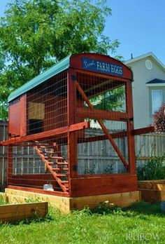 Chicken coop that you rotate from one raised bed to the next, allowing regrowth and garden rotation as well. Clever