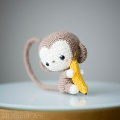 Crochet this adorable amigurumi monkey with our free crochet pattern! This monkey is part of our Chinese New Year series, and has poseable arms, a tail, and a cute banana to hold! Crochet Monkey, Cute Crochet, Crochet Dolls, Amigurumi Doll, Amigurumi Patterns, Crochet Patterns, Chinese New Year Monkey, Monkey Decorations, Cute Baby Monkey