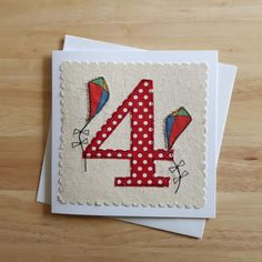 Cute little number 4 birthday card with appliqued kites. White 290gsm 5.25 x 5.25 inch card left blank inside, comes with a white envelope
