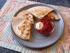 Protein Quesadillas   Servings:  2  Ingredients:          1 meatless/vegetable patty (ex. Boca or Morningstar Farms)     4  medium-size flour tortillas     1  cup shredded cheddar cheese   1/4 cup diced bell pepper (optional)
