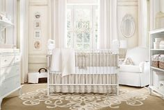 Traditional Kids Bedroom with Serena and lilly hudson crib, Pottery barn kids nursery bedding, Built-in bookshelf, Chandelier