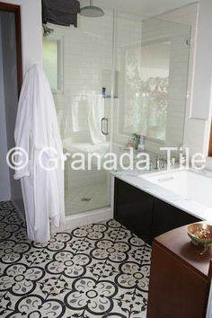 Granada Tile's Normandy cement tile design brings a dash of tradition to the more contemporary feel of a bathroom in a 1924 Spanish style house.
