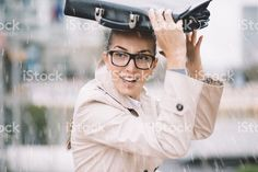 Business woman hiding from the rain royalty-free stock photo