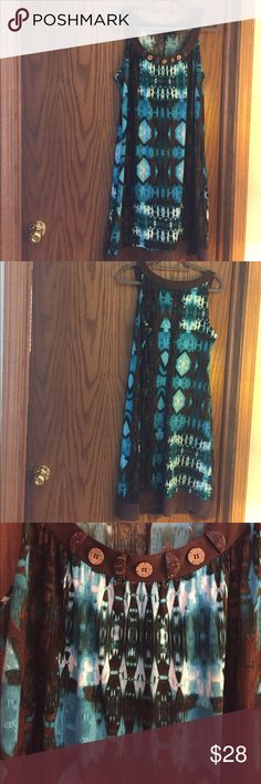 """Tribal print XL dress stretchy like new worn once New Directions XL tribal print dress attention getter!  Shoulder to hem 41"""" Armpit to armpit is 21"""" but that doesn't include maybe 2"""" of ease in front plus it stretches all over.  Will work for fuller busted.  Great dress like new worn once new directions Dresses"""