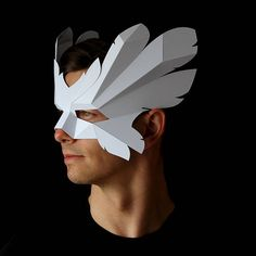 ICARUS Mask Make an easy winged mask from card with this PDF