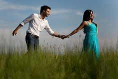 An Indian couple to-be has an engagement photo-shoot in the park amongst nature.