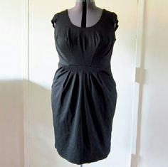 Figure flattering black maternity dress A black figure flattering dress with nice stretch and soft fabric. Has pockets in front. This wasn't sold as maternity but it fits like it in my opinion. Plenty of tummy room. RePosh. I've never worn this dress. Tags WERE attached when I received this. Just didn't work for what I wanted. Bravissimo Dresses