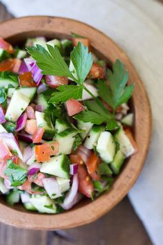 Jerusalem Salad is a flavor-packed dish made from the simplest ingredients: tomato, cucumber, red onion, and parsley. Perfect for topping a pita sandwich. Falafel Pita, Falafel Sandwich, Pita Sandwiches, Vegetarian Recipes, Cooking Recipes, Healthy Recipes, Jerusalem Salad, Healthy Recipe Books, Mediterranean Bowls