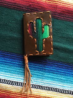 This+cactus+serape+wallet+measures+7+inches+by+4.5+inches+on+each+side,+yes+a+check+book+and+cash+fits!!+The+inside+has+two+alligator+skin+pockets+with+one+credit+card+holder+that+holds+multiple+cards!!