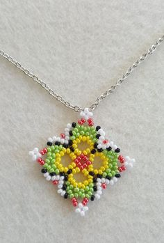 Best 12 Free pattern for pendant Stella – SkillOfKing. Beaded Jewelry Designs, Handmade Beaded Jewelry, Bead Jewellery, Earrings Handmade, Beaded Flowers Patterns, Beading Patterns, Beaded Rings, Beaded Bracelets, Beaded Ornaments