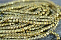 "Sam's Bead Shop: Hematite Cubes, Gold-Tone - 3mm - 15"" Strand #beads #gemstone #beading #jewelrymaking #diyjewelry #diyjewelrymaking #jewelrydesign #handmade #diy #accessories #samsbeadshop"