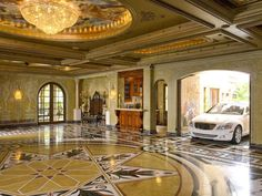 Now thats a garage! The Ultimate Mancave .Here's a $2M Private Garage That Doubles as a Ballroom