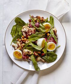 Roasted Cauliflower and Radish Salad With Soft-Cooked Eggs | This healthy, quick-cooking main is packed with wholesome ingredients—soft-cooked eggs, spinach, almonds, chickpeas, radishes, and cauliflowers—and then drizzled with a simple homemade vinaigrette.