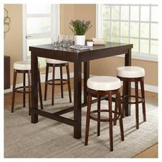 """When you think of a classic pub set this 5pc set comes to mind. A universal design, durable rubberwood construction and a rich espresso finish is equally at home in your dining room, kitchen or game room. The 30"""" swivel stools have cushioned seating in your choice of brown, gray, red or cream faux leather."""