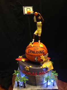 The basketball and stadium are made out of cake. Kobe, basketball hoop, and palm trees are made out of fondant. The lights are just individual battery operated lights stuck into the cake board. Cakes For Men, Cakes And More, Unique Cakes, Creative Cakes, Cupcakes, Cupcake Cakes, Beautiful Cakes, Amazing Cakes, Basketball Birthday