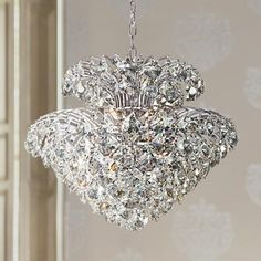 Iridescent clear crystals cover this two-tiered pendant light that is complemented with a gleaming chrome finish.