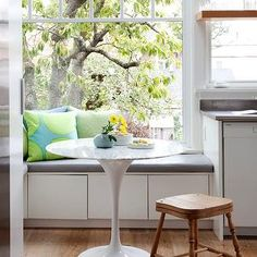 Sun filled kitchen window seat nook with white storage drawers topped with a gray bench cushion layered with lime green and turquoise pillows surrounding a marble topped Saarinen table paired with a vintage turned wood stool. White Storage Bench, Window Seat Storage, Storage Bench Seating, Storage Drawers, Floor Seating, Table Seating, Seating Plans, Bc Home, Window Benches