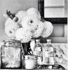 I like the idea of having a fresh vase of flowers in the bathroom for decor