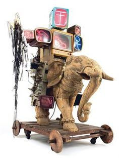 Nam June Paik, Alexander the Great, 1993, Mixed media, wooden sculpture with TV monitor and neon lights, 230x135x280 cm