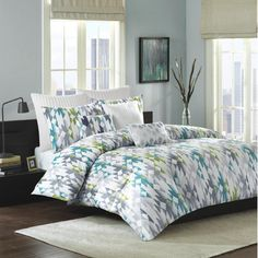 Make a stylish statement in your master suite or guest room with this lovely cotton duvet cover set, showcasing a cool-hued geometric pattern.