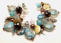 Ocean Beach Charm Bracelet 'Treasure Island' Chunky Beaded Beads Baubles Silver Plated Cha Cha Charms Beach Jewelry. $31.88, via Etsy.