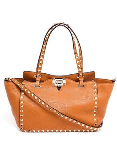 Shop Valentino Garavani 'Rockstud' trapeze tote in Browns from the world's best independent boutiques at farfetch.com. Over 1500 brands from 300 boutiques in one website.