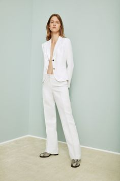 The perfect outfit to take you from desk to dinner: the crisp white linen suit jacket + dress pants from Calvin Klein.