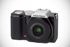 The new Pentax K-01 is another bold effort from the manufacturer that is known for pushing camera size, color, durability, and now, design, to the limit. The contemporary, timeless K-01 houses a full array of advanced functions and user-friendly features in a camera body with remarkable form and function.