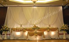 Toronto Wedding Decorations - Custom Backdrop and Head Table Draping Design by Mapleleaf Decorations in Gold satin and ivory sheer fabrics at the Hilton Hotel. Contact us for more info www.MapleleafDecorations.com