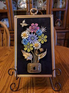 "Framed Jewelry Art of colorful bouquet of ""flowers"" with gold accent and butterfly. This is made by me and is a ONE OF A KIND. Stand not included. My hobby began with wanting to do crafts again after the kids grew up and left home. 