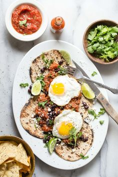 Easy huevos rancheros with beef chorizo and topped with two runny fried eggs. This is a breakfast fit for a king and perfect for the weekend.