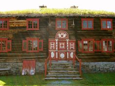 Traditional Norwegian Home, grass growing on the roof, as is common in the country. The sod is laid over a base layer of birch bark, which is waterproof. The layer of sod insulates the home during the cold winters and saves on fuel.
