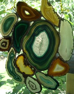 Agate Stained Glass.  I buy these slices of agate at the Gem and Rock Show when they have them and sometimes I find them at the local Gem and Rock Shops in big cities.  They have them already cut for you.
