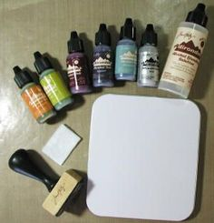 Alcohol inks in assorted colors, Alcohol Blending Solution*, Applicator and white felt rectangle (applicator is a hand stamp with hook side of Velcro® attached), Mixative, Craft mat